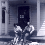 Mom, me, and Dad on the porch on Watson St. in Toledo Ohio