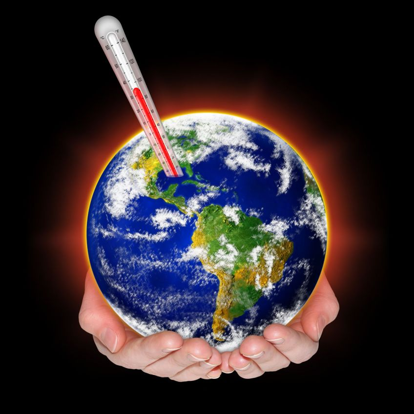 Planet Earth with a fever, held in hands