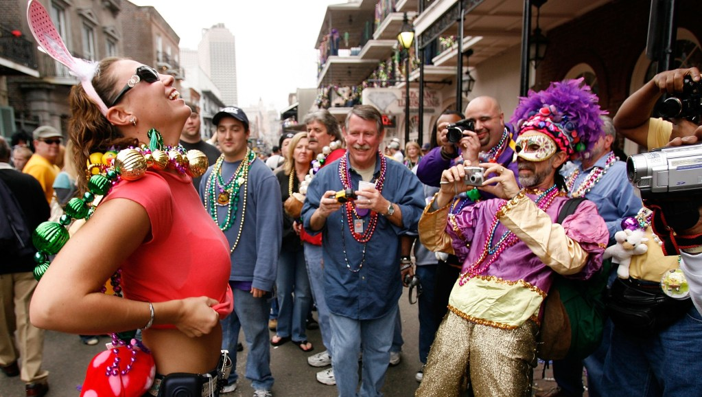 NEW ORLEANS - FEBRUARY 20:  A group of revelers with cameras wait to capture a moment on Bourbon Street on Mardi Gras Day, February 20, 2007 in New Orleans, Louisiana. This is the second Mardi Gras celebration since Hurricane Katrina devasted the Gulf Coast region.  (Photo by Chris Graythen/Getty Images)