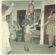 Christmas 1967 at Ed's-Steve whacking pinata made by Carolyn