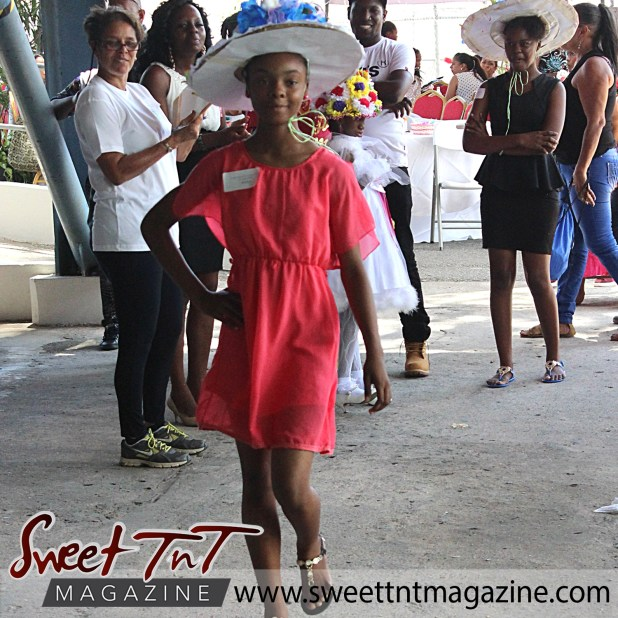 Teenage girl in pink dress and blue flowered bonnet with gold sandals at special needs children Easter Bonnet parade at Queen's Park Cricket Club, color eggs, Sweet T&T, Sweet TnT, Trinidad and Tobago, Trini, vacation, travel