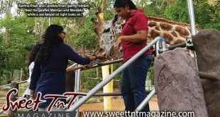 Katrina Khan and Candida Khan feed giraffes Melman and Mandela, on visit at Emperor Valley Zoo, Sweet T&T, Sweet TnT, Trinidad and Tobago, Trini, vacation, travel, petting