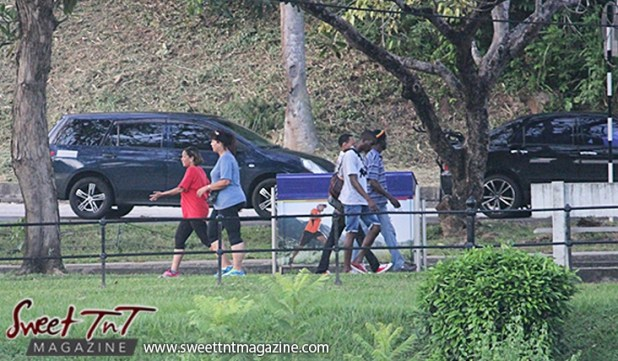 2 women and 3 men walking Queens Park Savannah Port of Spain for How to lose weight story in Sweet T&T, Sweet TnT, Trinidad and Tobago, Trini, vacation, travel