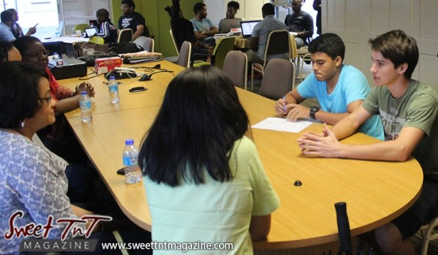 Two young men make presentation to investors at Launch Rockit in sweet t&t for Sweet TnT Magazine in Trinidad and Tobago