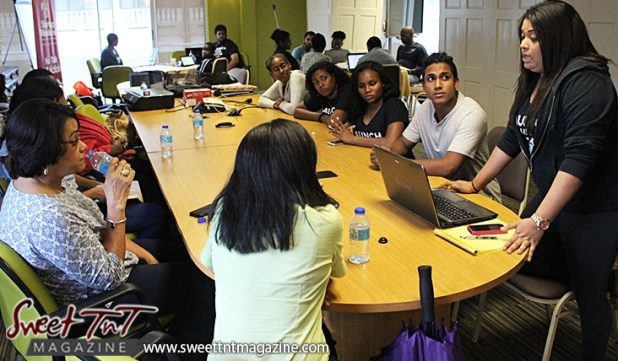 Woman raises hand during presentation of business idea at Launch Rockit in sweet t&t for Sweet TnT Magazine in Trinidad and Tobago