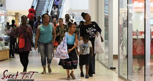 Women and children shopping and spend wisely at Trincity Mall for holiday in sweet t&t for Sweet TnT Magazine in Trinidad and Tobago