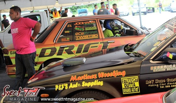 Drift orange race car with ads for Drifters in Wallerfield article by Marika Mohammed in sweet T&T for Sweet TnT Magazine, Culturama Publishing Company, for news in Trinidad, in Port of Spain, Trinidad and Tobago, with positive how to photography.
