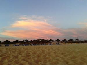 Sunbeds and parasols at sunset