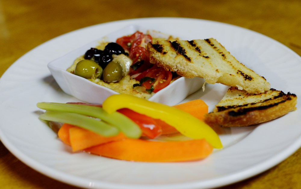 Topped with toasted walnuts, olives and marinated tomatoes. Served with warm bread and crudité