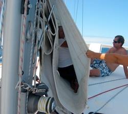 Karen inside sail to make a repair