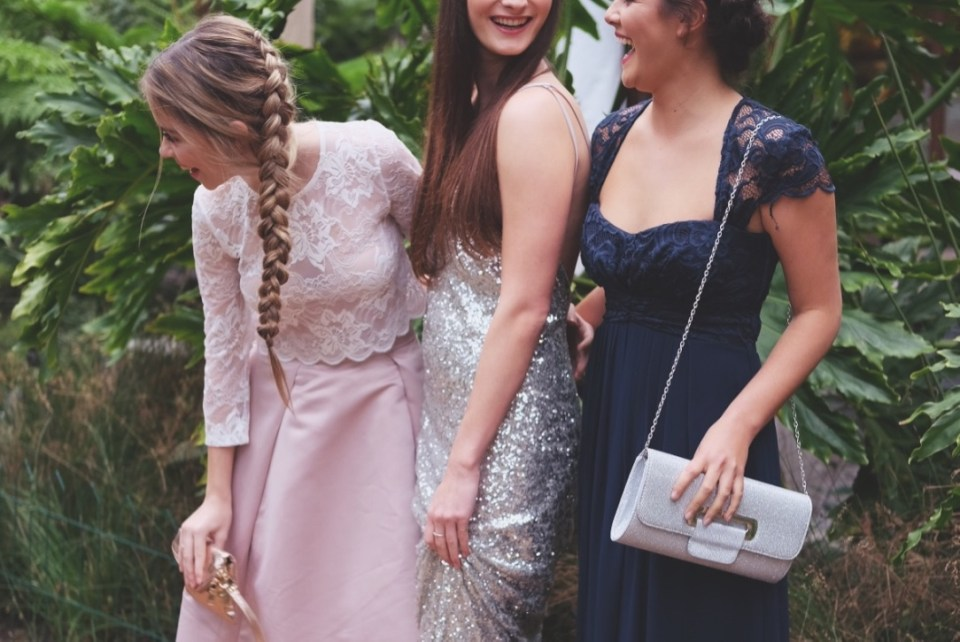 girls laughing in prom dresses