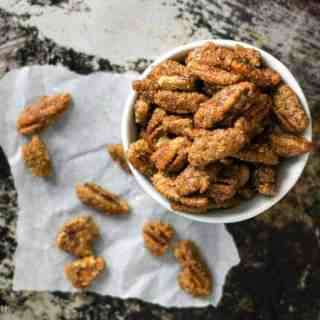 These crispy pecans are coated in brown sugar and the spices of a gingersnap cookie! Ginger, cinnamon, cloves, and a touch of molasses! These gluten-free pecans will make you think you are eating your favorite gingersnap cookies! Gingersnap Pecans Recipe | Take Two Tapas