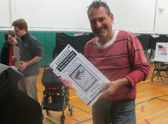 "My vote: # 104 at this machine. Election Monitor Jim Harald kindly took the photo and gave me an ""I Voted"" sticker."