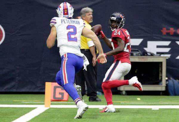 Texans cornerback Johnathan Joseph intercepted a pass from Nathan Peterman and returned it for a touchdown to give Houston the lead on Sunday. CreditMichael Wyke/Associated Press