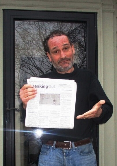 David Kramer holding the ever vanishing Speaking Out section of the Rochester Democrat and Chronicle, 1/5/19
