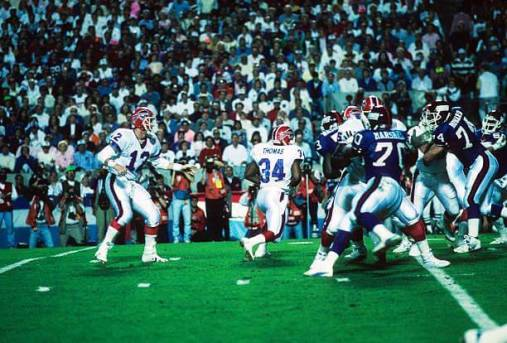 Super Bowl XXV: Buffalo Bills QB Jim Kelly (12) in action, handoff to Thurman Thomas (34) vs New York Giants at Tampa Stadium. Tampa, FL 1/27/1991 CREDIT: Dick Raphael (Photo by Dick Raphael /Sports Illustrated/Getty Images)