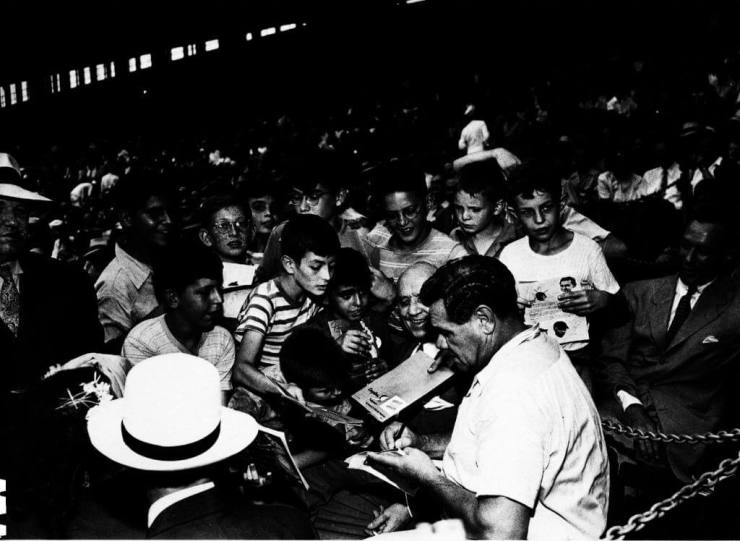 "Babe Ruth signing autographs in 1944. From His Life and Legacy"" Babe Ruth *CENTENNIAL SPORTS* 2018 [David Kramer's collection]"