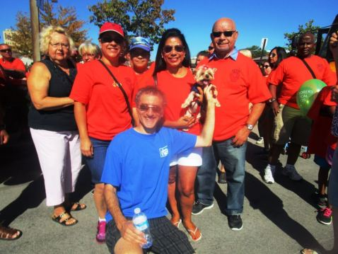 Stefan Cohen (blue RTA shirt) in front of Dilia Olmeida (orange BENTE shirt) and canine friend. Labor Day, 2016