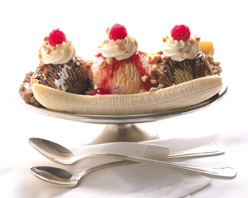 Spoons and Banana Split --- Image by © Royalty-Free/Corbis