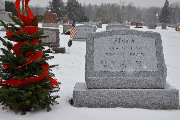 At Christmas friends and family signed the ribbon on the tree by Mack's grave.