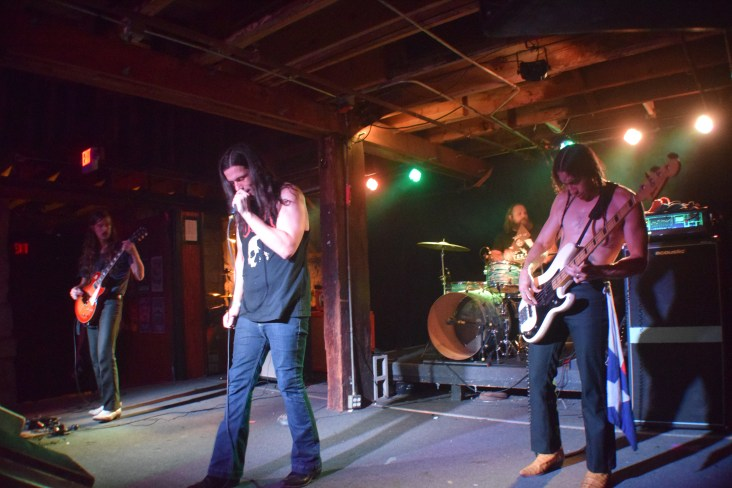 Pictured left to right: Bones (guitar), Cody (vocals), Caleb (drums), and Shock (bass) from the band Sweat Lodge.