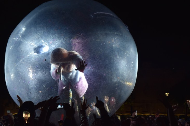 """Wayne Coyne getting out into the crowd during The Flaming Lips cover of David Bowie's song, """"Space Oddity"""" during The Major Rager (2017) in Augusta, Ga."""