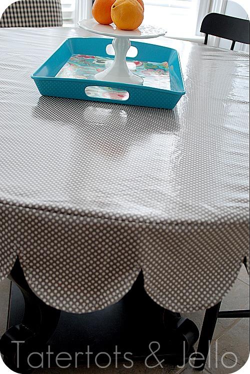 Laminated scalloped tablecloth close up