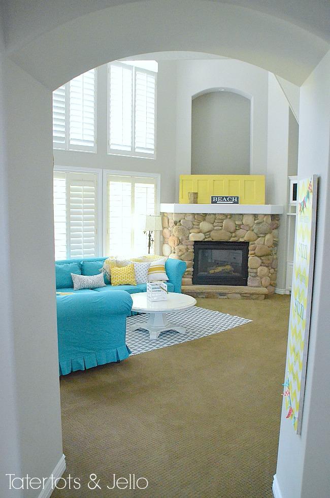 turquoise slipcover and yellow mantel door