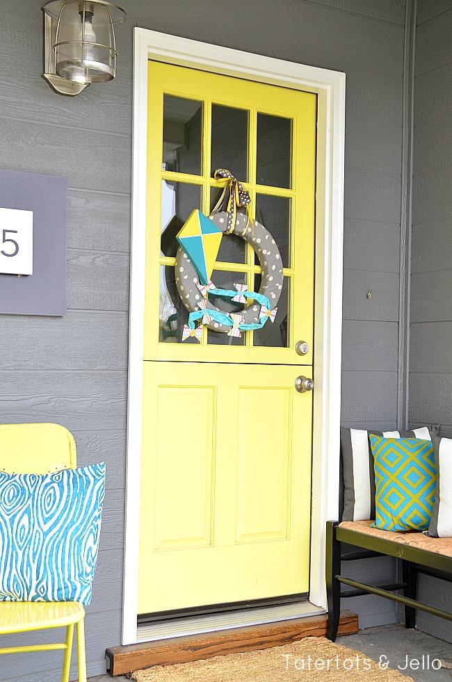 wooden kite wreath tutorial at tatertots and jello