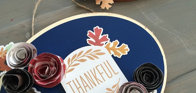 Easy Thanksgiving Door Hanging. Make a Door Hanging with an inexpensive wood slice, paper and embellishments. Find out how easy it is to make and how to make rolled paper flowers!