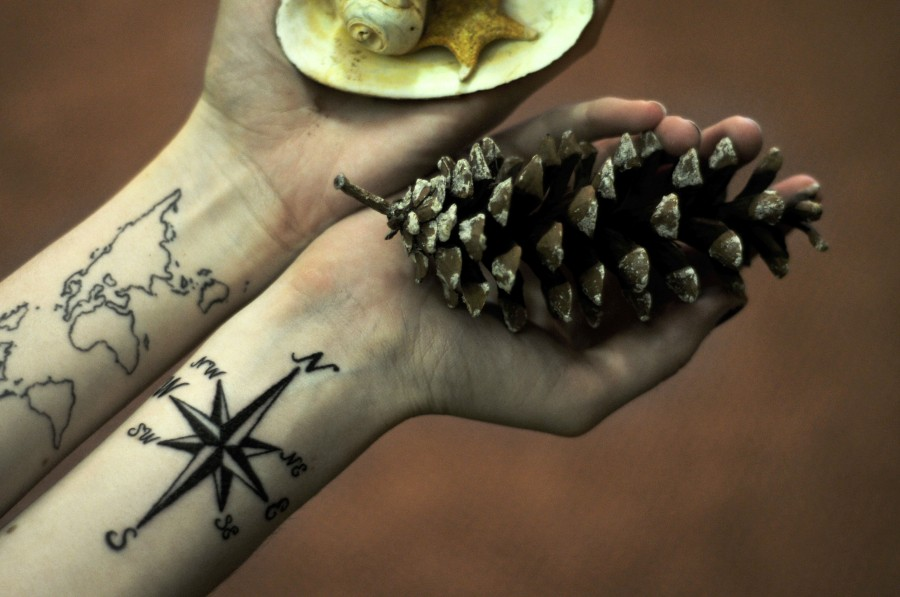 travel tattoo world map and compass pinecone   TattooMagz travel tattoo world map and compass pinecone