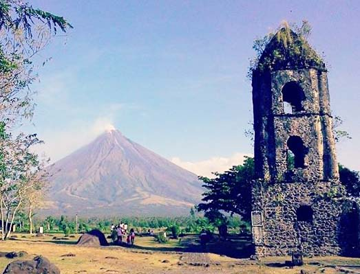 THE CAGSAWA RUINS. Several towns were buried when Mayon Volcano erupted in 1814. Cagsawa, a baroque-inspired church built by Franciscan friars back in the 1724 was buried with lava leaving only the bell tower and part of the facade of the church behind.