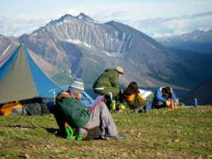 Alaska Wildlands Studies students work on required reading with Timothy Bartholomaus in the Wrangell Mountains of Alaska.