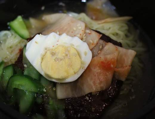 Bibim Naeng Myeong: Chewy korean noodles served cold, with a chilli sauce and radish pickles.