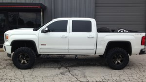 2014 GMC Sierrra 1500 Fabtech lift Fuel Beast wheels AMP power steps