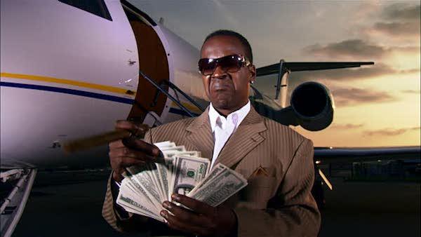 black man with money