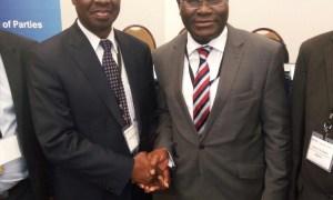 Shola Taylor (right), Secretary-General of CTO congratulating Patick Masambu (left), Director-General of ITSO