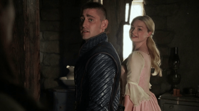 a screencap of will scarlet (played by michael socha) and anastasia (played by emma rigby) about to jump into the looking glass
