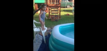 Little Girl Rolls Around Edge Of Inflatable Pool   YouTube