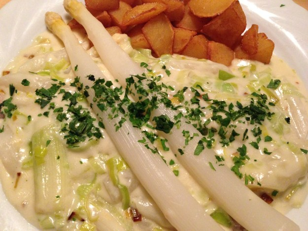Local beef cooked in beer, smothered in a Bärlauch cream sauce, and topped with white asparagus. Bärlauch grows wild in the foothills of the Alps and in the woods ringing Vienna, and is closest to the garlic scapes of eastern North America.