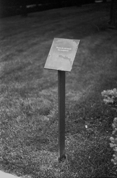 Research Photograph, Signage, Donald J. Hall Sculpture Park, Nelson-Atkins Museum, Kansas City, MO 2014. Photo by the author.