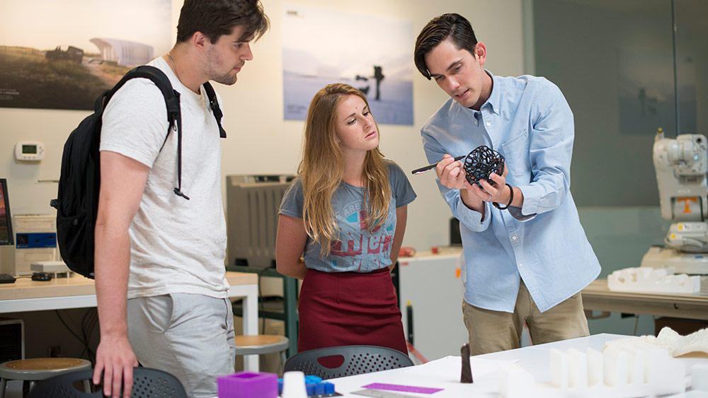students examine a 3-D printed model