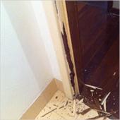 Picture shows termites have damaged door frames.