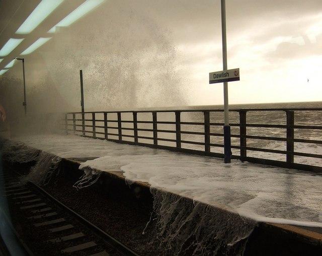Sea breaking onto platform at Dawlish station, copyright Derek Harper, licensed for reuse (CC BY-SA 2.0)