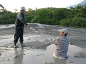 Mud can act like quicksand. WeiLi Hong needed a helping hand during his research in southern Taiwan. (Photo courtesy of WeiLi Hong)