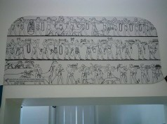 Three horizontal registers with ancient Egyptian workers bringing animals and ritual offerings