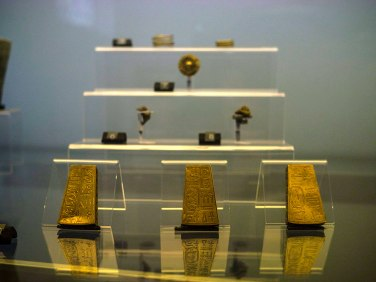 Three rectangular gold pendants inscribed with hieroglyphs