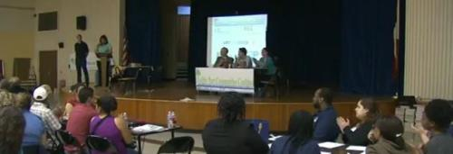 Residents filled the Holland Middle School auditorium to hear the preliminary results of neighborhood surveys and to share their concerns with local officials.