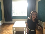 E in our (as yet unfurnished) living room.