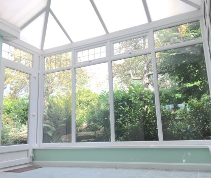Conservatory (sunroom? I've heard different terms) facing the rear garden.